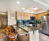 Kitchen, hallway to bedroom and condo entrance