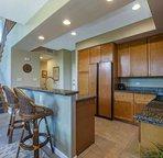 Granite countertops in the fully stocked kitchen
