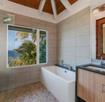 Peak at the ocean while you relax in the tub!