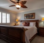 Master Bedroom with a King Bed, Ceiling Fan & TV