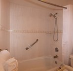 Shower featuring hand-held shower handle