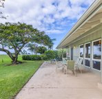 Outdoor seating with golf course and ocean views.