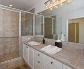 The Master Bath has a Large Walk-in Shower, with a Bench, and Dual Sinks