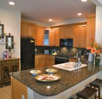 Granite Countertops and Travertine Tiled Floors, Up-To-Date Appliances