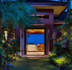 Entryway through carved doors and lushly landscaped courtyard. Ocean view from courtyard!