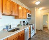 Kitchen area has dishwasher, a rarity for Waikiki condos!