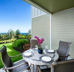 Covered lanai perfect for outdoor meals and to take in the Ocean Views