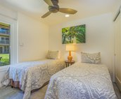 Twin Bedroom with view of the Lanai and pool.