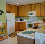 Fully equipped kitchen is open to the dining area and living room.