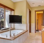 Master Bathroom with Soaking Tub and Flat Screen TV
