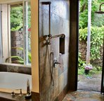 Master Bathroom with Soaking Tub and Walk in Tiled Shower leading to Outdoor Shower