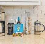 Enjoy all types of coffee in this fully equipped kitchen.