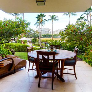 Watch your family splash around in the Lagoon Pool while you relax on the lanai.