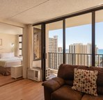Every room has floor to ceiling windows in the living area that opens up to the private lanai