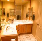 The master bath features a tub and shower, his and hers vanities and a hair dryer.