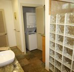 Large full bath with stack washer/dryer