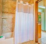 En-suite master bathroom with shower/tub combo