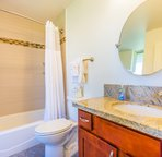 Main bathroom with washer and dryer. Full tub and shower. Your condo will also be stocked with beach towels.