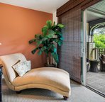 Master bedroom sitting area with access to private lanai