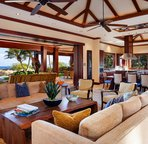 Spacious great room with vaulted ceilings and automatic pocket doors to the lanai & pool deck, for luxurious Hawaiian indoor/outdoor living.