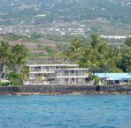 Water view looking at Kona Riviera. #203 top floor left side of building.