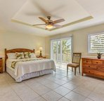 Bedroom 3 with Cal-King Bed & Access to Lanai.  Located on the Main level