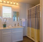 Plantation style bathroom with subway tile and Hans-Grohe fixtures.