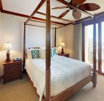 The Master Bedroom has a King Size Canopy Bed, Ceiling Fan, and Private Access to the Lanai