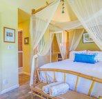Master bedroom with en-suite bathroom and TV room.