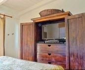 TV armoire in master bedroom