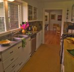 Galley kitchen with slate tile and butcherblock counters.  Updated appliances and washer/dryer.