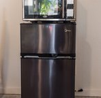 Microwave and fridge with freezer.