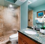 Second bathroom includes a walk-in shower