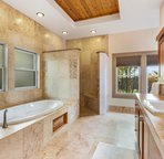 Master Bathroom with Tub and Tiled Walk In Shower