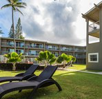 Rexlax next to the sand or splash in the pool. Kauai Kailani has it all!