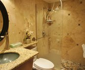 Tiled bathroom with walk-in shower
