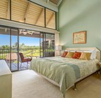 Master Bedroom with a Cal King Bed and Lanai Access