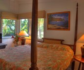 Guest room featuring a king poster bed with adjoining guest bath.  There is an additional guest bedroom featuring twin beds.