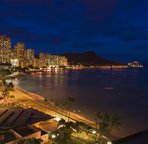 View of Waikiki Beach at night looking towards Diamond Head