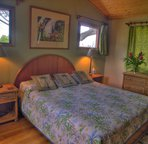 "The upper master suite is a delightful, airy room above the surrounding foliage, you even have an ""ocean glimpse""."