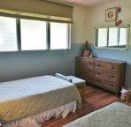 Bedroom 2 includes 2 twin beds