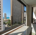 Peek at the ocean from the bedroom.  Lots of palm trees below (not thirty floors down!)  give a tropical feel which is sometimes hard to find  in the middle of Waikiki
