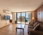 Large  cozy living room area, all flooring are fully tiled.  Full view sliding glass windows to the lanai.  Beautiful view of the ocean.  Wifi equipped, cable includes just under 161 channels for your viewing pleasure.  Dining are with seating for four comfortably.