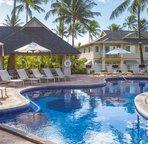Kai Lani's Pool with Umbrellas and Lounge Chairs