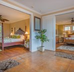 Plantation style old Hawaiian living--this is two master suites.