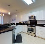 Fully Equipped Kitchen with New Stainless Appliances