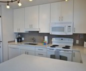 Kitchen With In Unit Washer And Dryer