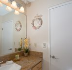 Guest bathroom featuring washer and dryer.