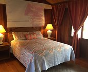 Guest Bedroom with Hardwood Floors and Vaulted Ceilings
