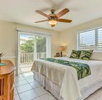 Bedroom 4 with King Bed & Lanai Access. Located on the Main Level